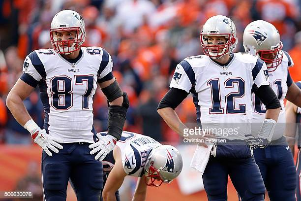 Rob Gronkowski and Tom Brady of the New England Patriots look on in the first half against the Denver Broncos in the AFC Championship game at Sports...