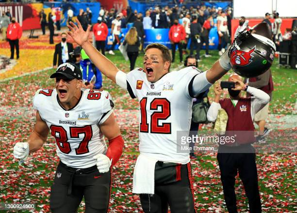 Rob Gronkowski and Tom Brady of the Tampa Bay Buccaneers celebrate after defeating the Kansas City Chiefs in Super Bowl LV at Raymond James Stadium...