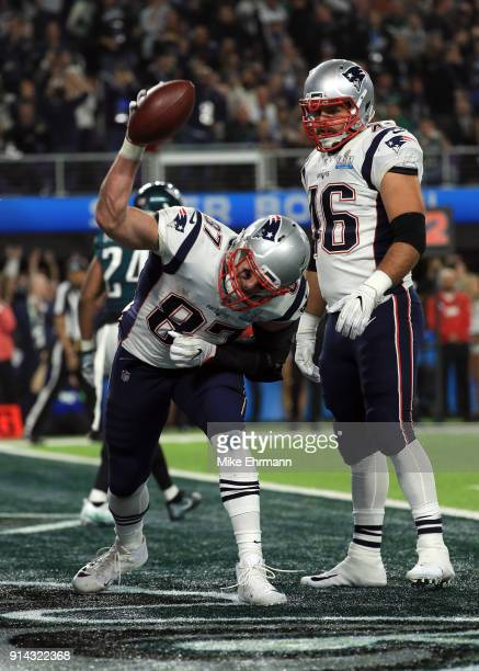 Rob Gronkowski celebrates his 5 yard touchdown reception with James Develin of the New England Patriots against the Philadelphia Eagles during the...
