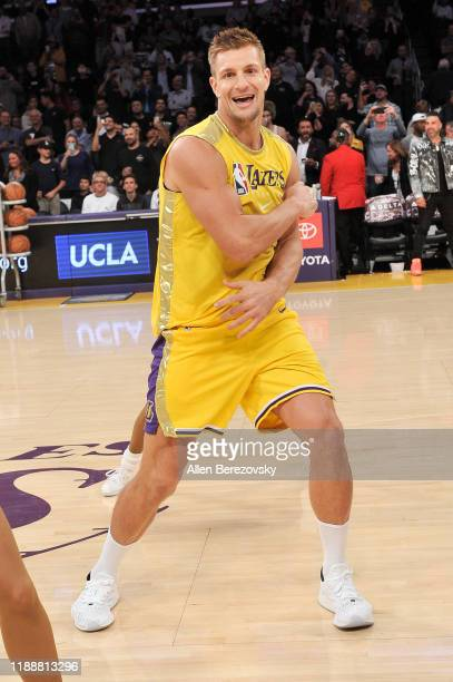 Rob Gronkowski dances with the Laker Girls during halftime at a basketball game between the Los Angeles Lakers and the Oklahoma City Thunder at...