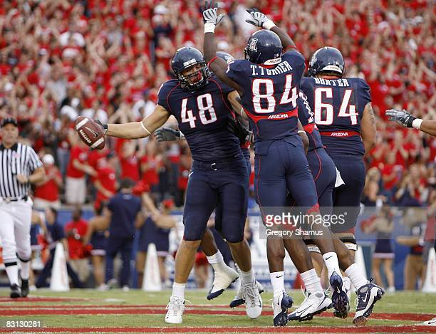 Rob Gronkowski of the Arizona Wildcats celebrates a first quarter touchdown with Terrell Turner and Colin Baxter while playing the Washington Huskies...