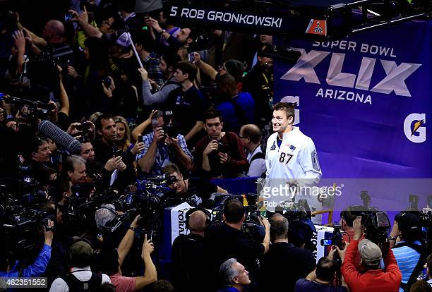 Rob Gronkowski of the New England Patriots addresses the media at Super Bowl XLIX Media Day Fueled by Gatorade inside US Airways Center on January 27...
