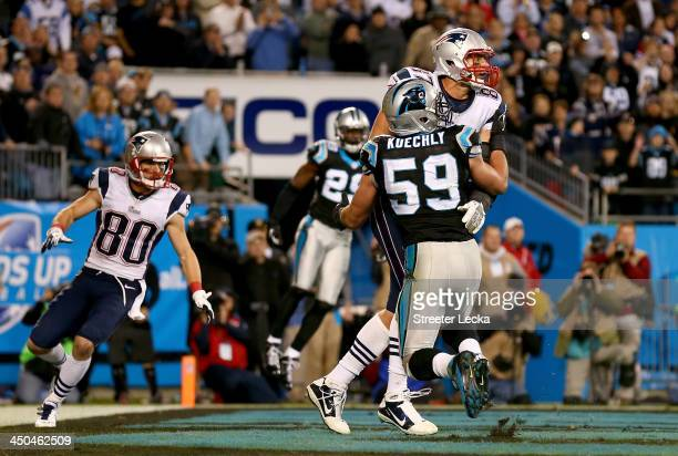 Rob Gronkowski of the New England Patriots and Luke Kuechly of the Carolina Panthers fight for the ball in the end zone on the last play of the game...