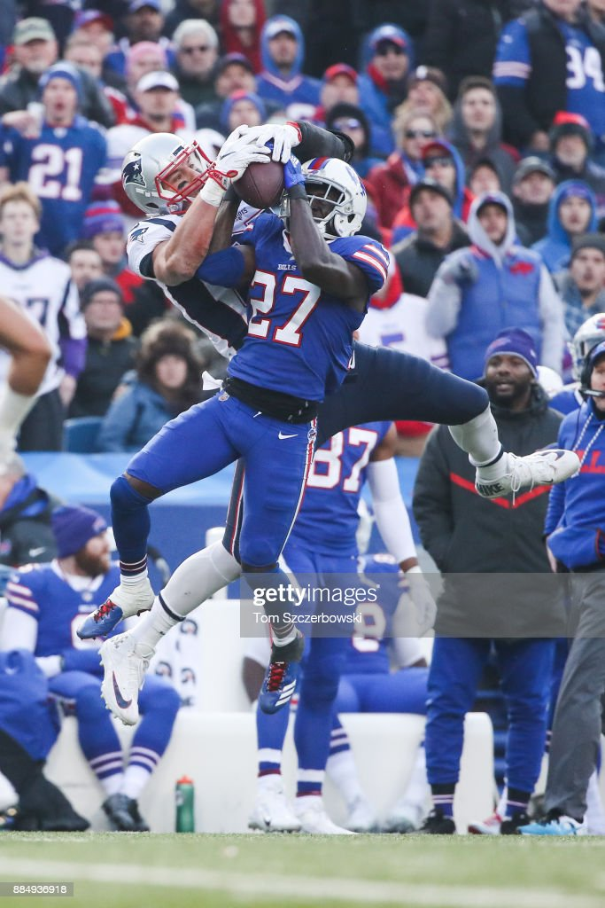 Rob Gronkowski #87 of the New England Patriots and Tre'Davious White #27 of the Buffalo Bills attempt to catch the ball during the fourth quarter on December 3, 2017 at New Era Field in Orchard Park, New York.