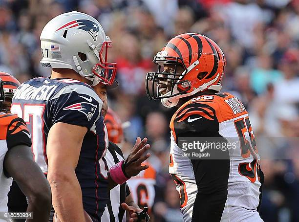 Rob Gronkowski of the New England Patriots and Vontaze Burfict of the Cincinnati Bengals exchange words in the fourth quarter at Gillette Stadium on...