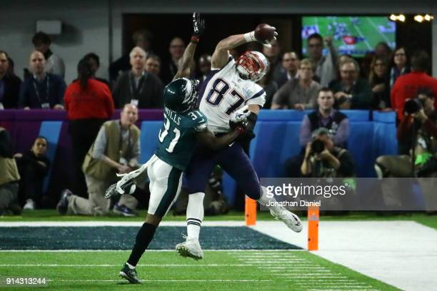 Rob Gronkowski of the New England Patriots attempts a catch defended by Jalen Mills of the Philadelphia Eagles in the second quarter of Super Bowl...