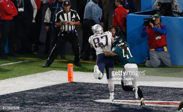 Rob Gronkowski of the New England Patriots brings in the ball for a fouryard touchdown reception during the game against the Philadelphia Eagles in...