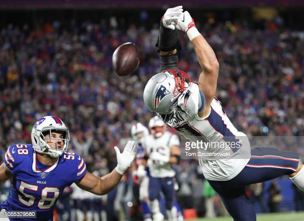 Rob Gronkowski of the New England Patriots cannot catch a pass during NFL game action as Matt Milano of the Buffalo Bills defends at New Era Field on...