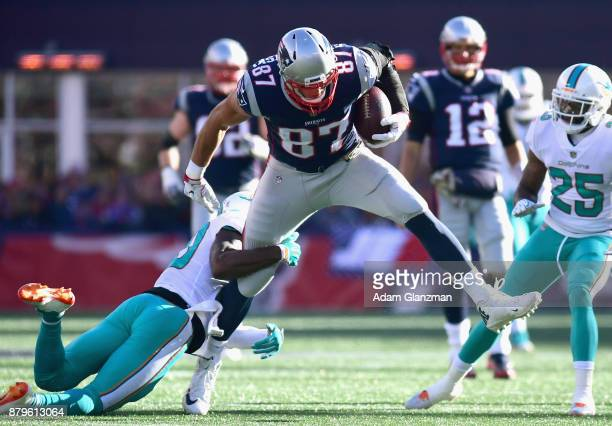 Rob Gronkowski of the New England Patriots carries the ball after a catch during the first quarter of a game against the Miami Dolphins at Gillette...