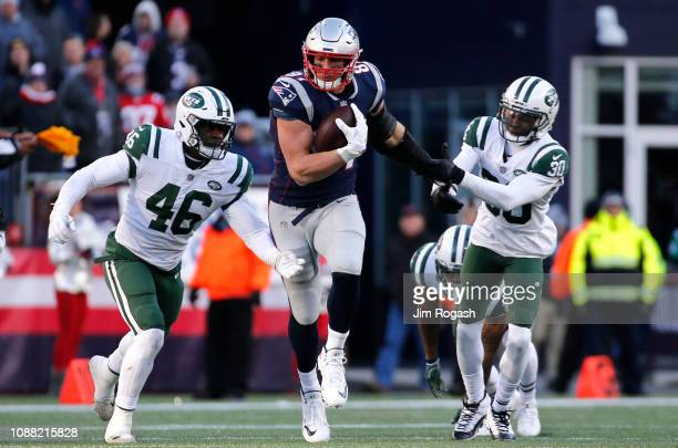 Rob Gronkowski of the New England Patriots carries the ball during the third quarter of game against the New York Jets at Gillette Stadium on...