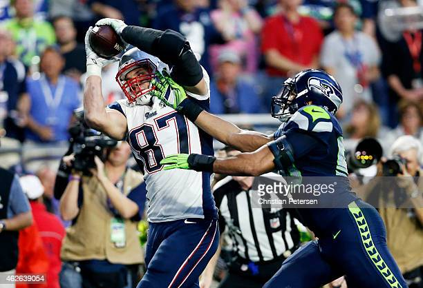 Rob Gronkowski of the New England Patriots catches a 22 yard pass for a touchdown over KJ Wright of the Seattle Seahawks in the second quarter during...
