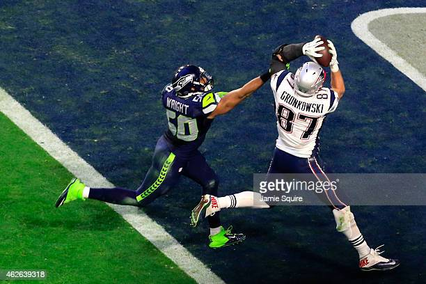 Rob Gronkowski of the New England Patriots catches a 22 yard touchdown pass against KJ Wright of the Seattle Seahawks in the second quarter during...
