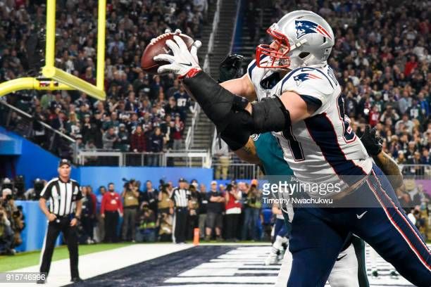 Rob Gronkowski of the New England Patriots catches a 4yard touchdown pass past Ronald Darby of the Philadelphia Eagles during the fourth quarter in...