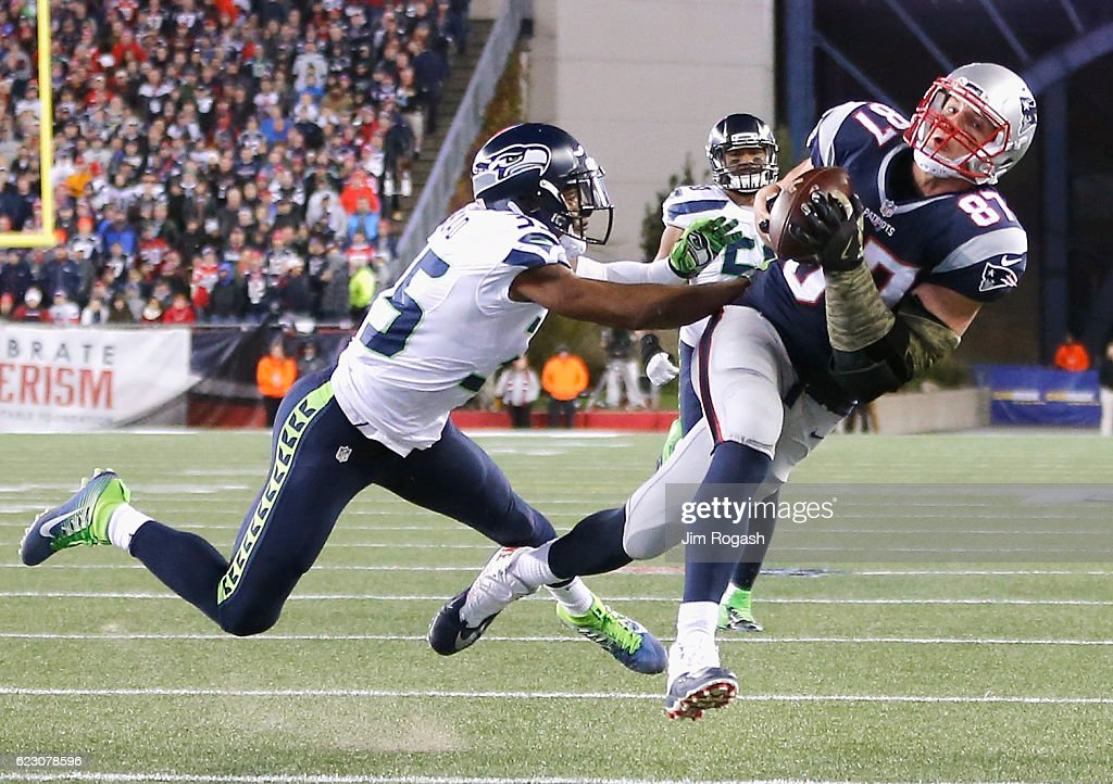 Rob Gronkowski #87 of the New England Patriots catches a pass as he is defended by DeShawn Shead #35 of the Seattle Seahawks during the fourth quarter of a game at Gillette Stadium on November 13, 2016 in Foxboro, Massachusetts.