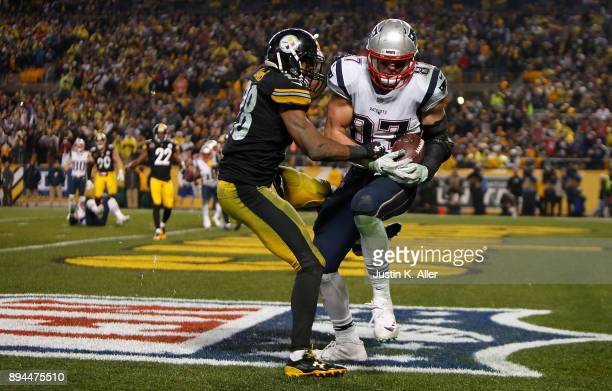Rob Gronkowski of the New England Patriots catches a pass in front of Sean Davis of the Pittsburgh Steelers for a two point conversion in the fourth...