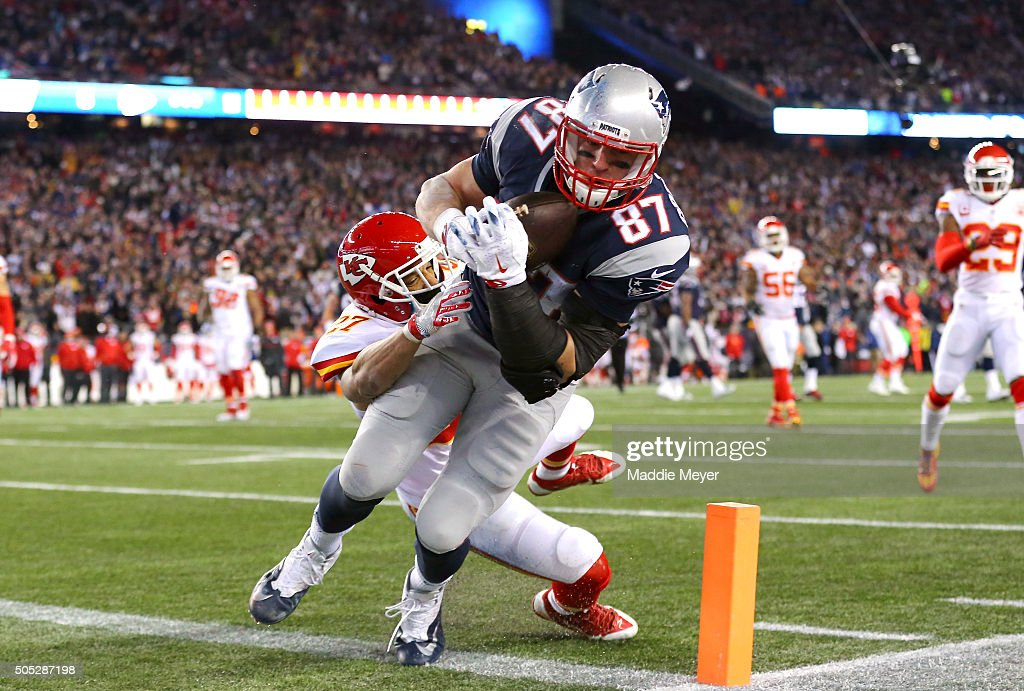 Rob Gronkowski #87 of the New England Patriots catches a touchdown in the third quarter against Tyvon Branch #27 of the Kansas City Chiefs during the AFC Divisional Playoff Game at Gillette Stadium on January 16, 2016 in Foxboro, Massachusetts.