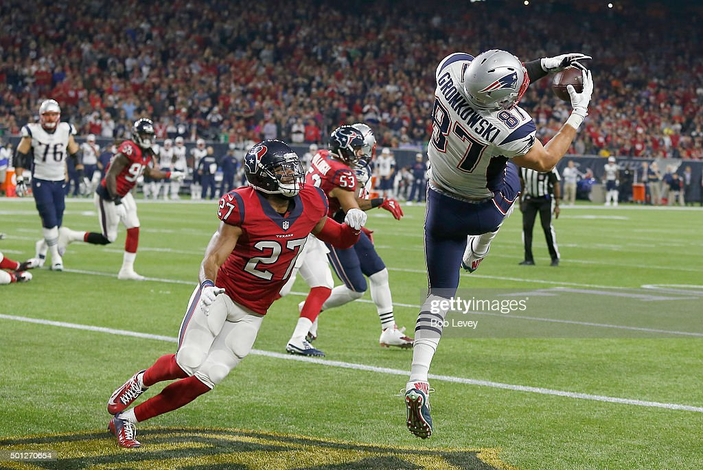 Rob Gronkowski #87 of the New England Patriots catches a touchdown pass against Quintin Demps #27 of the Houston Texans in the second quarter on December 13, 2015 at NRG Stadium in Houston, Texas.
