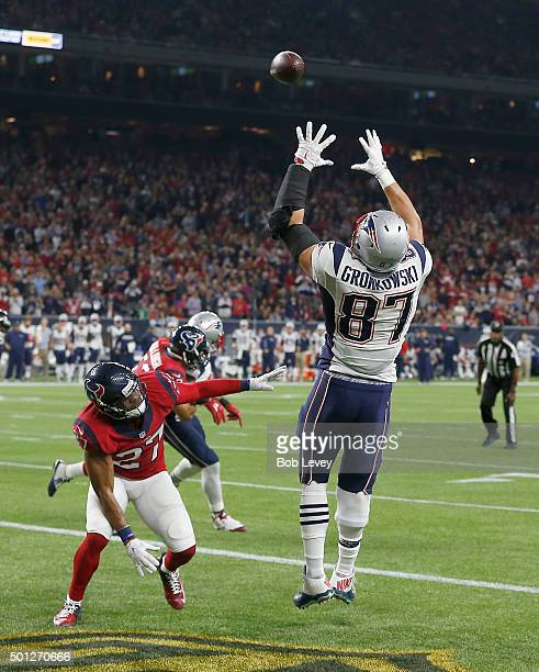 Rob Gronkowski of the New England Patriots catches a touchdown pass against Quintin Demps of the Houston Texans in the second quarter on December 13,...