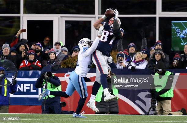 Rob Gronkowski of the New England Patriots catches a touchdown pass as he is defended by Kevin Byard of the Tennessee Titans during the fourth...