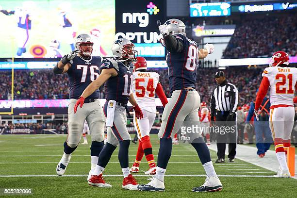 Rob Gronkowski of the New England Patriots celebrates a first quarter touchdown with teammates Julian Edelman and Sebastian Vollmer against the...