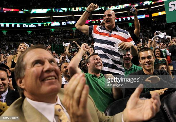 Rob Gronkowski of the New England Patriots celebrates as Patriots head coach Bill Belichick looks on during Game Four of the Eastern Conference...