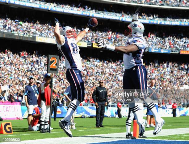 Rob Gronkowski of the New England Patriots celebrates his touchdown with Alge Crumpler for a 73 lead over the San Diego Chargers during the first...