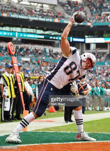 Rob Gronkowski of the New England Patriots celebrates his touchdown in the second quarter against the Miami Dolphins at Hard Rock Stadium on December...