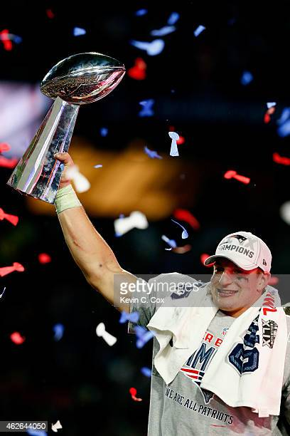 Rob Gronkowski of the New England Patriots celebrates while holding up the Vince Lombardi Trophy after defeating the Seattle Seahawks during Super...