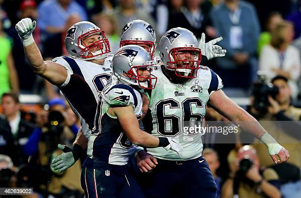 Rob Gronkowski of the New England Patriots celebrates with his team after scoring a touchdown on a 22 yard pass against the Seattle Seahawks in the...