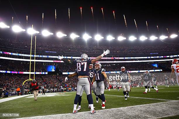 Rob Gronkowski of the New England Patriots celebrates with teammates after scoring his second touchdown against the Kansas City Chiefs in the third...
