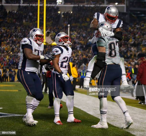 Rob Gronkowski of the New England Patriots celebrates with teammates after catching a pass for a two point conversion in the fourth quarter during...