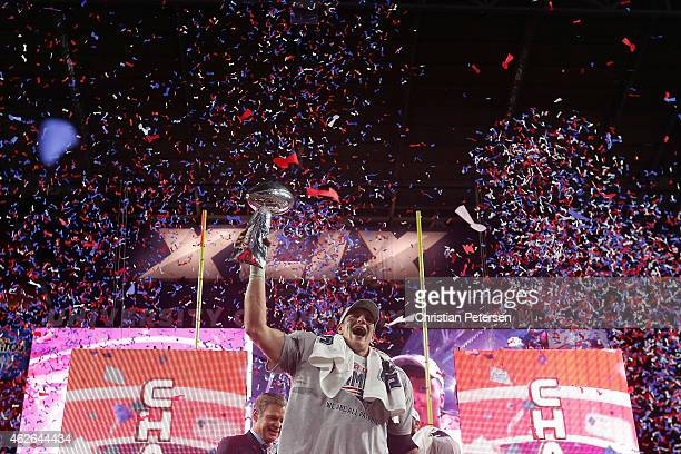 Rob Gronkowski of the New England Patriots celebrates with the Vince Lombardi Trophy at the trophy ceremony after defeating the Seattle Seahawks 2824...