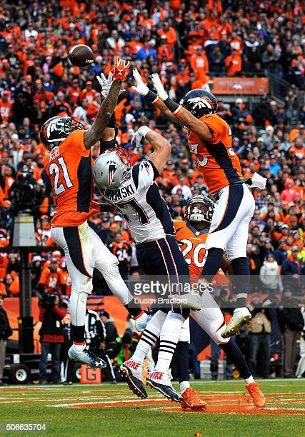 Rob Gronkowski of the New England Patriots fails to make a catch in the fourth quarter against Aqib Talib and Shiloh Keo of the Denver Broncos in the...