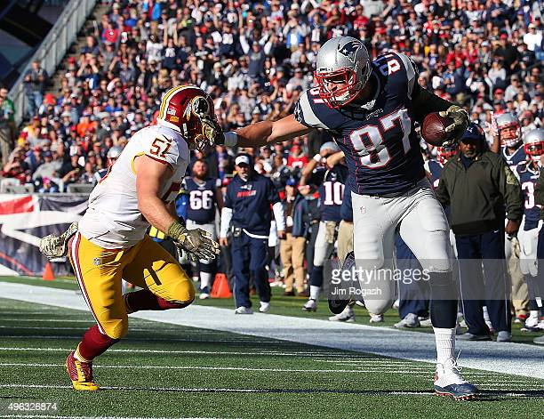Rob Gronkowski of the New England Patriots gets by Will Compton of the Washington Redskins in the second half against the Washington Redskins at...