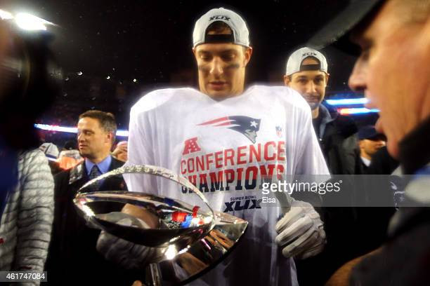 Rob Gronkowski of the New England Patriots holds the Lamar Hunt Trophy after defeating the Indianapolis Colts in the 2015 AFC Championship Game at...