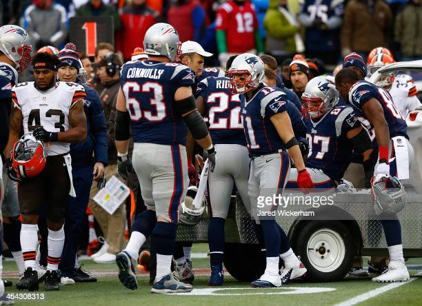 Rob Gronkowski of the New England Patriots is carted off of the field in the third quarter after being tackled by members of the Cleveland Browns...