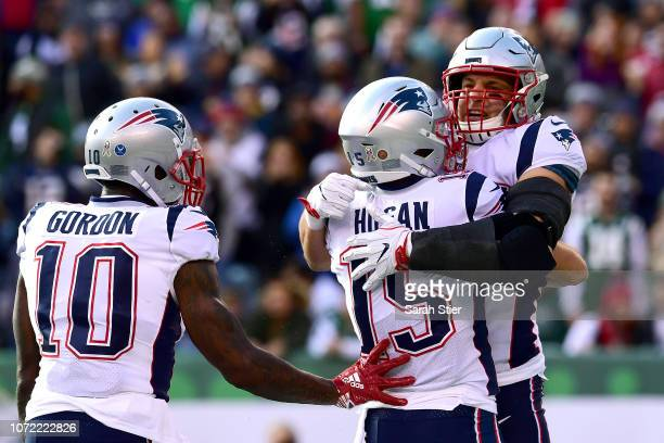 Rob Gronkowski of the New England Patriots is congratulated by his teammates Chris Hogan and Josh Gordon after his first quarter touchdown reception...