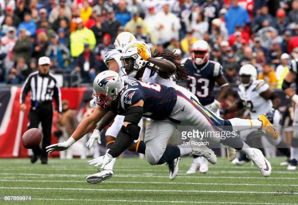 Rob Gronkowski of the New England Patriots is defended by Tre Boston of the Los Angeles Chargers as he breaks up a pass during the second quarter of...