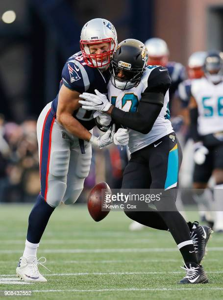 Rob Gronkowski of the New England Patriots is hit by Barry Church of the Jacksonville Jaguars in the second quarter during the AFC Championship Game...