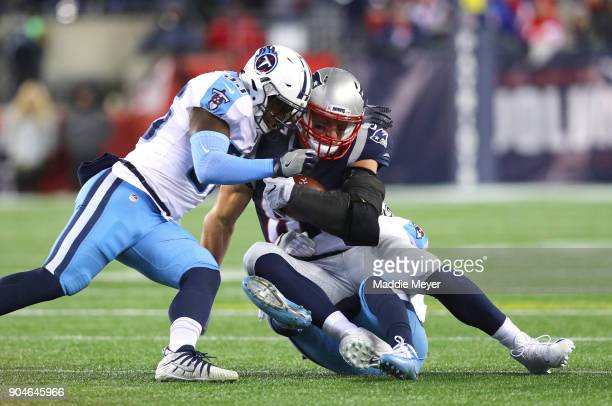 Rob Gronkowski of the New England Patriots is tackled after a catch by Jurrell Casey of the Tennessee Titans in the second quarter of the AFC...