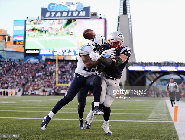 Rob Gronkowski of the New England Patriots is unable to catch a pass in the end zone as Daimion Stafford of the Tennessee Titans defends him during...