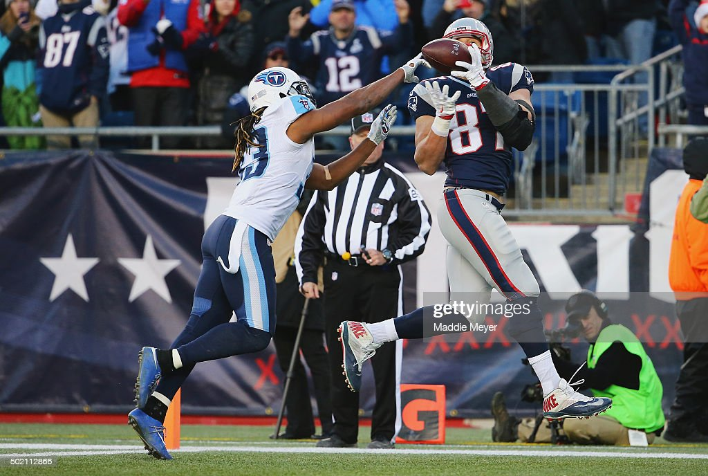 Rob Gronkowski #87 of the New England Patriots is unable to catch a pass in the end zone as Michael Griffin #33 of the Tennessee Titans defends him during the second half at Gillette Stadium on December 20, 2015 in Foxboro, Massachusetts.
