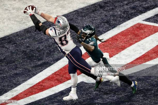 Rob Gronkowski of the New England Patriots makes a 42yard touchdown reception against Ronald Darby of the Philadelphia Eagles in Super Bowl LII at US...