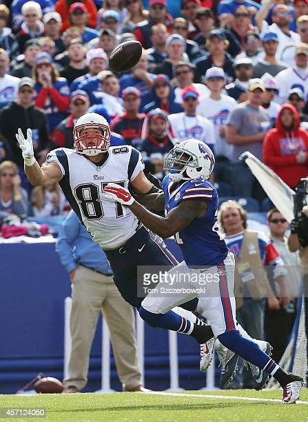 Rob Gronkowski of the New England Patriots makes a catch in front of Duke Williams of the Buffalo Bills during the second half at Ralph Wilson...
