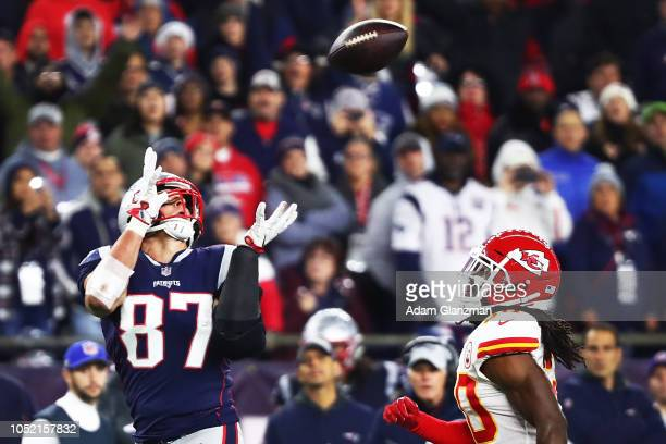 Rob Gronkowski of the New England Patriots makes a catch while under pressure from Josh Shaw of the Kansas City Chiefs in the fourth quarter of a...