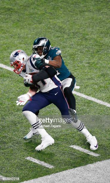 Rob Gronkowski of the New England Patriots makes a reception as Corey Graham of the Philadelphia Eagles tackles him in Super Bowl LII at US Bank...