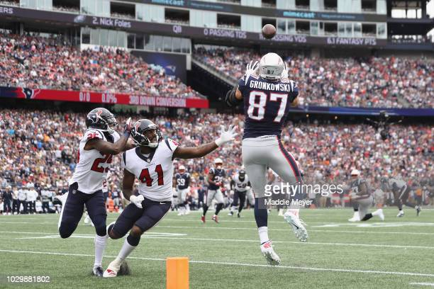 Rob Gronkowski of the New England Patriots makes a touchdown reception during the first quarter against the Houston Texans at Gillette Stadium on...