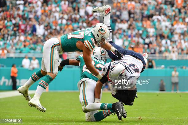 Rob Gronkowski of the New England Patriots makes the catch during the second quarter against the Miami Dolphins at Hard Rock Stadium on December 9...