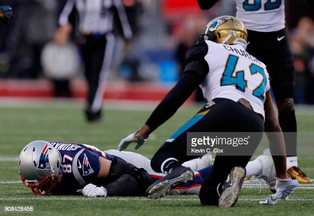 Rob Gronkowski of the New England Patriots reacts after an injury after being hit by Barry Church of the Jacksonville Jaguars in the second quarter...