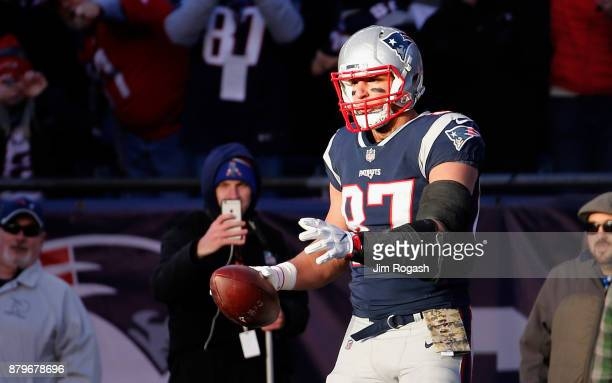 Rob Gronkowski of the New England Patriots reacts after catching a touchdown pass during the third quarter of a game against the Miami Dolphins at...